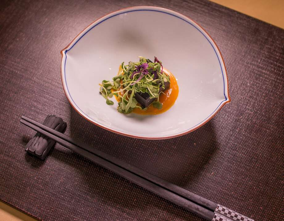 House made squid ink fish cake with carrot purée at Omakase. Photo: John Storey, Special To The Chronicle
