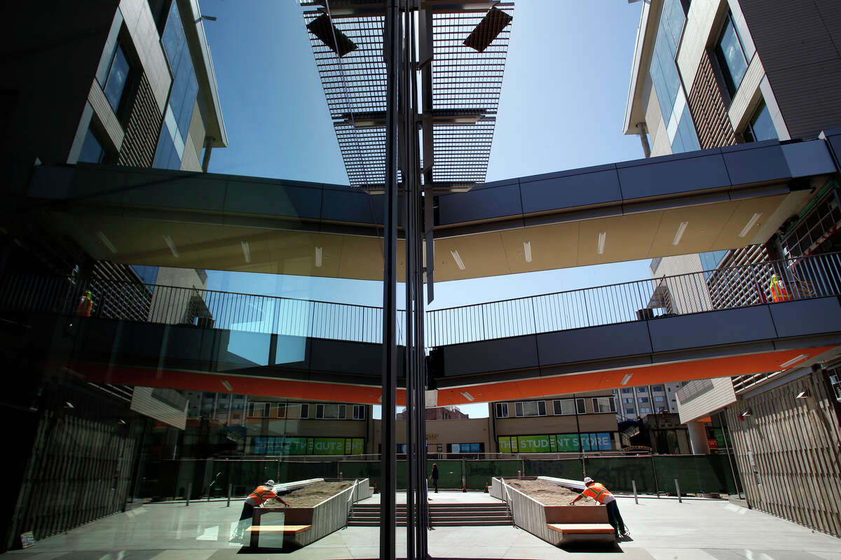 Elevated walkways, reflected in windows, are adding to the transformation of Lower Sproul Plaza on the UC Berkeley campus.