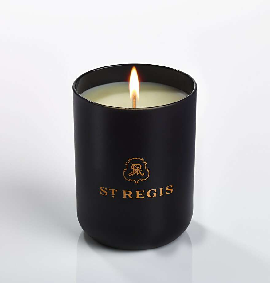 "St. Regis Hotels and Resorts is introducing a new signature scent in October, in a candle called ""Caroline's Four Hundred,"" that will be burned in all the company's 34 lobbies. The fragrance name is a reference to the matriarch of the family that founded the hotels, Caroline Astor, and the candle has notes of exotic wood, Champagne, roses, and green stems. Available for $80 at www.stregis.com/boutique in October, 2015. Photo: Courtesy Of St. Regis"