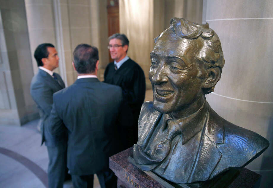 A bust of Harvey Milk serves as a backdrop for the marriage ceremony of Peter Shields (left) and Raul Hernandez, which was performed by C.W. Nevius. Photo: Paul Chinn / Paul Chinn / The Chronicle / ONLINE_YES