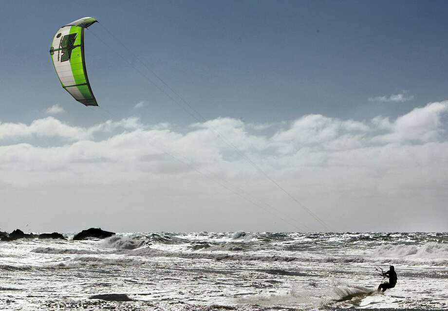A kitesurfer was injured at Ocean Beach Friday afternnon. In this file photo, kitesurfer Jeff Kafka follows his kite along Montara Beach. Photo: Chris Hardy, SFC