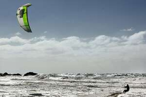 Kite-surfer hit by car after wind blows him onto highway - Photo