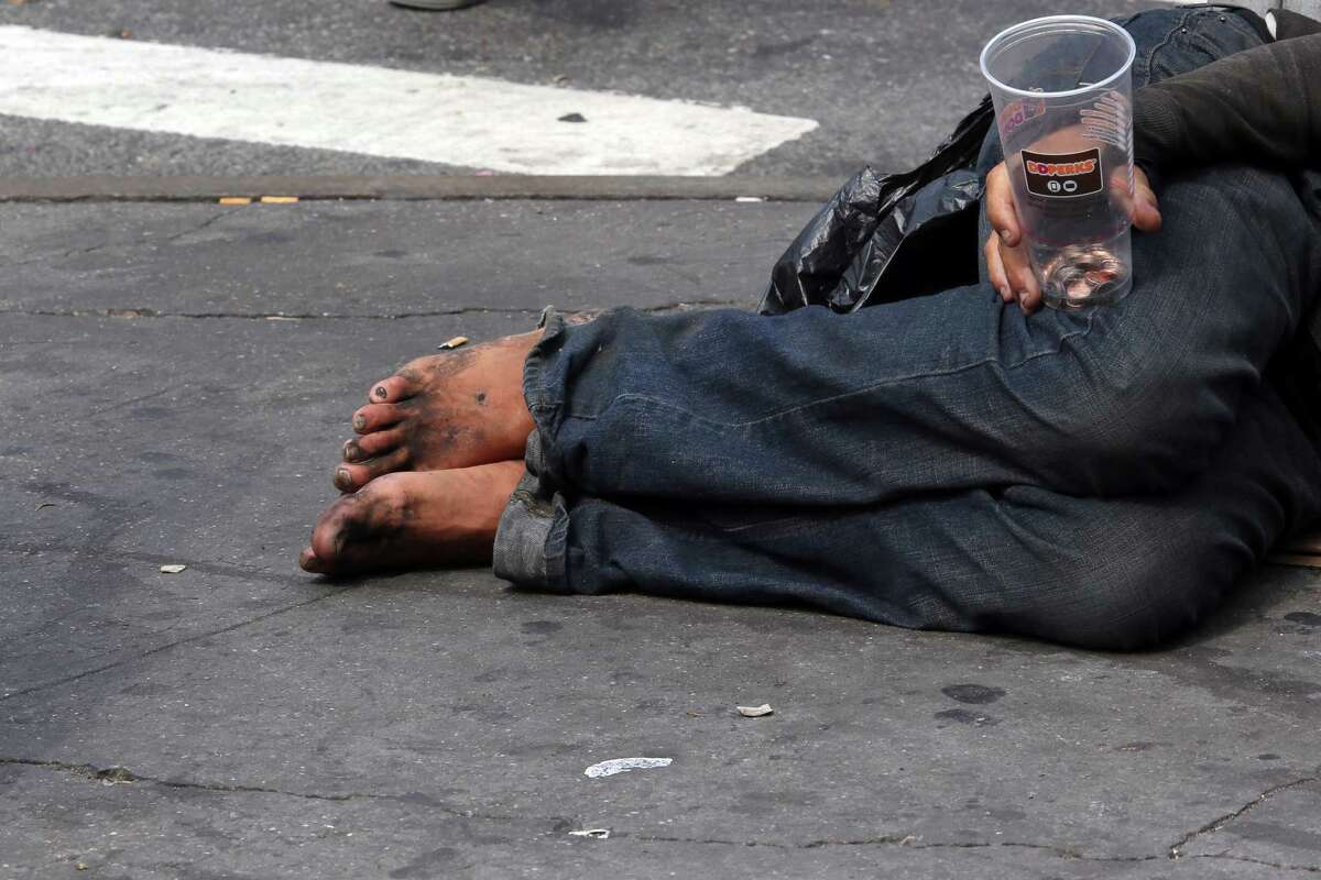 A homeless man asks for money on 14th Street, Friday, Sept. 4, 2015, in New York. The number of homeless on New York City's streets has increased, prompting breathless media coverage and worries that the