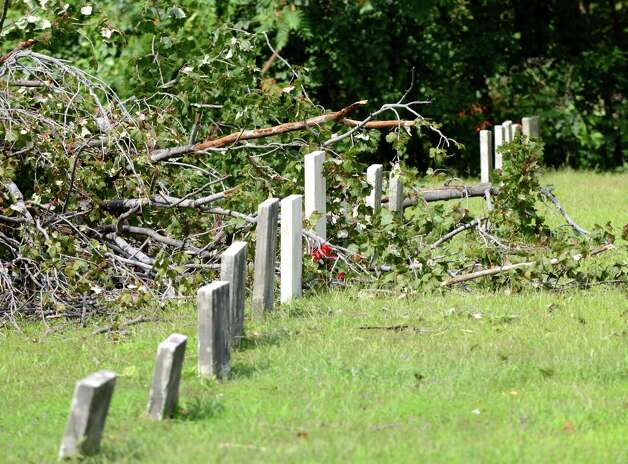 At least eight gravestones were damaged at the historic Shaker cemetery Friday, Sept. 4, 2015, after high winds from a strong storm Thursday toppled trees in Colonie, N.Y. (Will Waldron/Times Union) Photo: Will Waldron / 00033244A