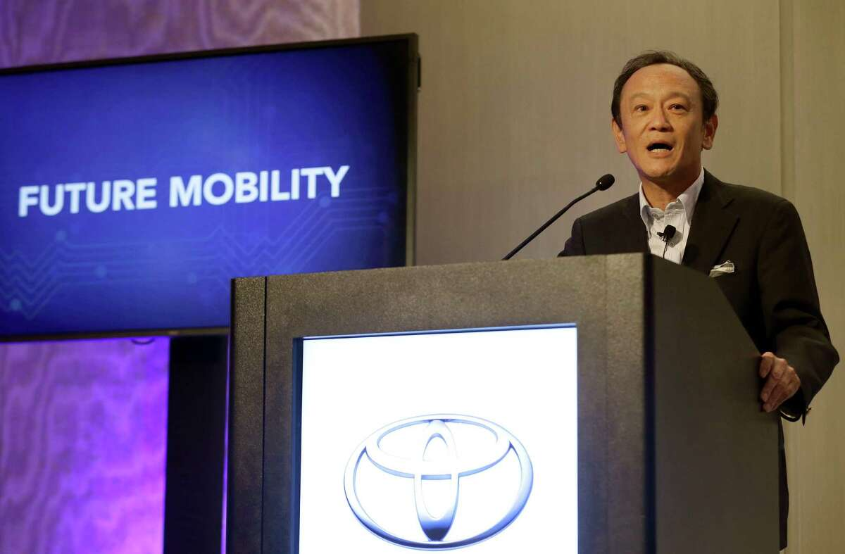 Kiyotaka Ise, Senior Managing Officer for Toyota Motor Corporation, speaks at a news conference in East Palo Alto, Calif., Friday, Sept. 4, 2015. Toyota announced it is investing $50 million with Stanford University and the Massachusetts Institute of Technology in hopes of gaining an edge in an accelerating race to phase out human drivers. (AP Photo/Jeff Chiu) ORG XMIT: CAJC101