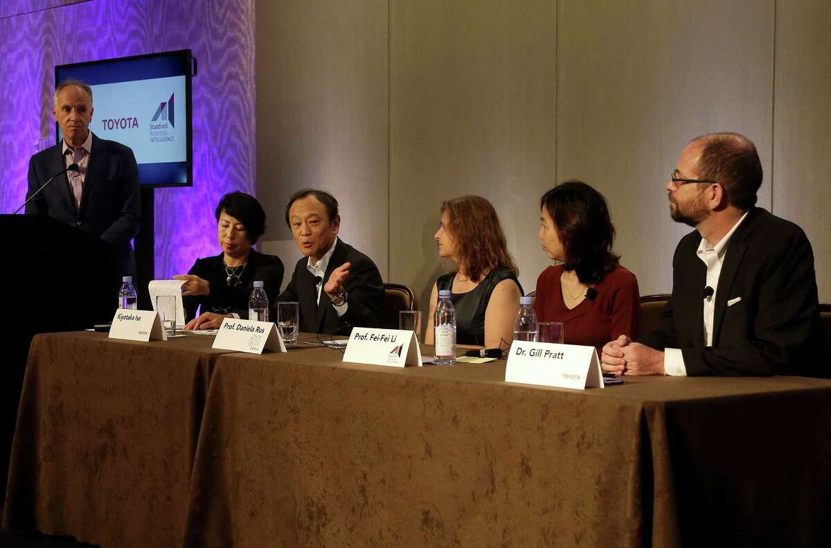 Kiyotaka Ise, Senior Managing Officer for Toyota Motor Corporation, third from left, speaks at a news conference with Chuck Gulash, Toyota Senior Executive Engineer, left, Daniela Rus, professor at MIT, third from right, Fei-Fei Li, associate professor at Stanford, and Dr. Gill Pratt, a former program manager at the U.S. government's Defense Advanced Research Projects Agency, in East Palo Alto, Calif., Friday, Sept. 4, 2015. Toyota announced it is investing $50 million with Stanford University and the Massachusetts Institute of Technology in hopes of gaining an edge in an accelerating race to phase out human drivers. (AP Photo/Jeff Chiu) ORG XMIT: CAJC103