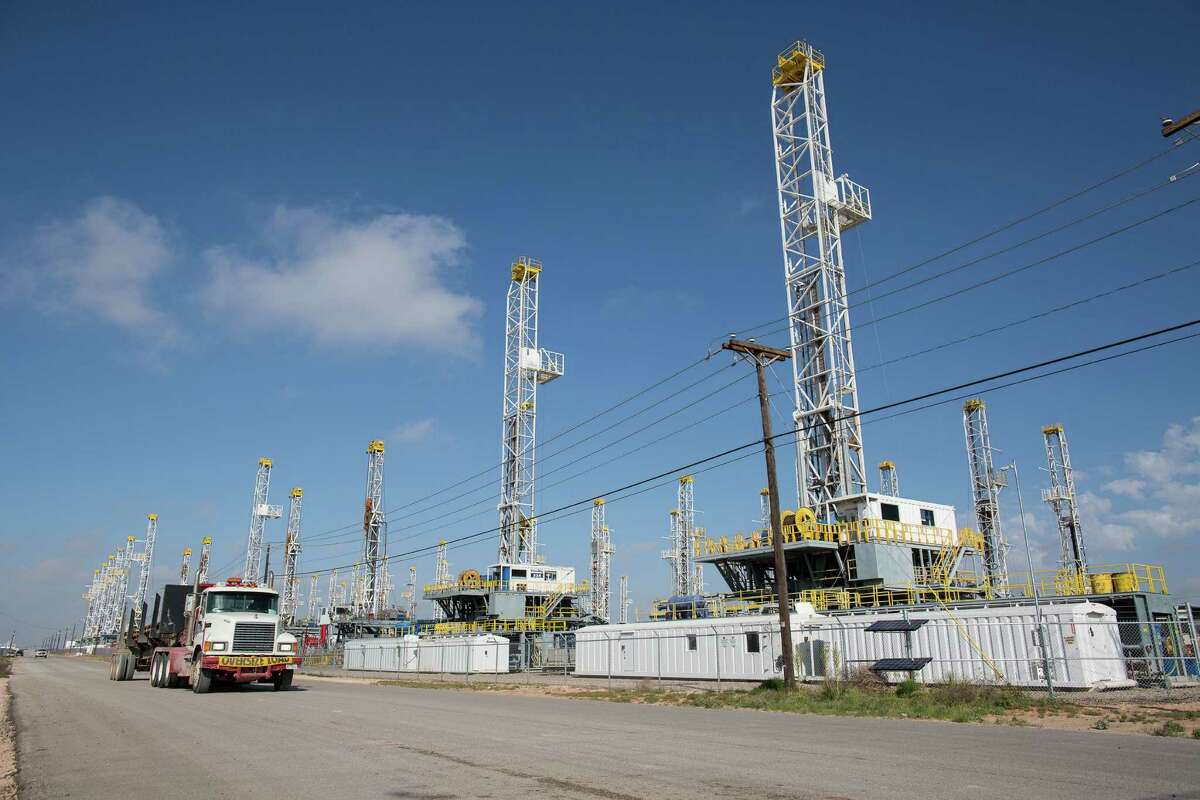 A decrease in U.S. oil drilling that left these rigs stacked idle in West Texas may mean production will start to slow. (Courtney Sacco/Odessa American via AP)