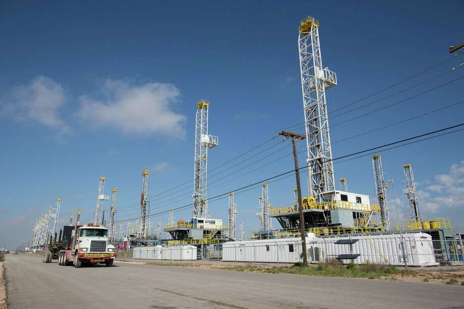 A decrease in U.S. oil drilling that left these rigs stacked idle in West Texas may mean production will start to slow.   (Courtney Sacco/Odessa American via AP) Photo: Courtney Sacco, MBO / Odessa American