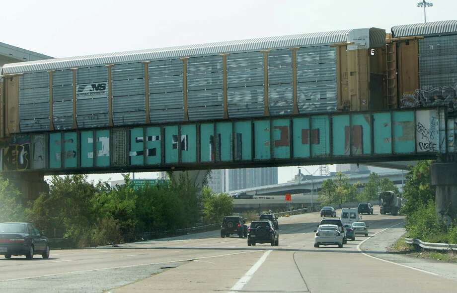 "The ""Be Someone"" art is seen altered again along Interstate 45, Thursday, Aug. 13, 2015, in Houston. (Cody Duty / Houston Chronicle) Photo: Cody Duty, Staff / © 2015 Houston Chronicle"