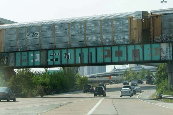 "The ""Be Someone"" art is seen altered again along Interstate 45, Thursday, Aug. 13, 2015, in Houston. (Cody Duty / Houston Chronicle)"