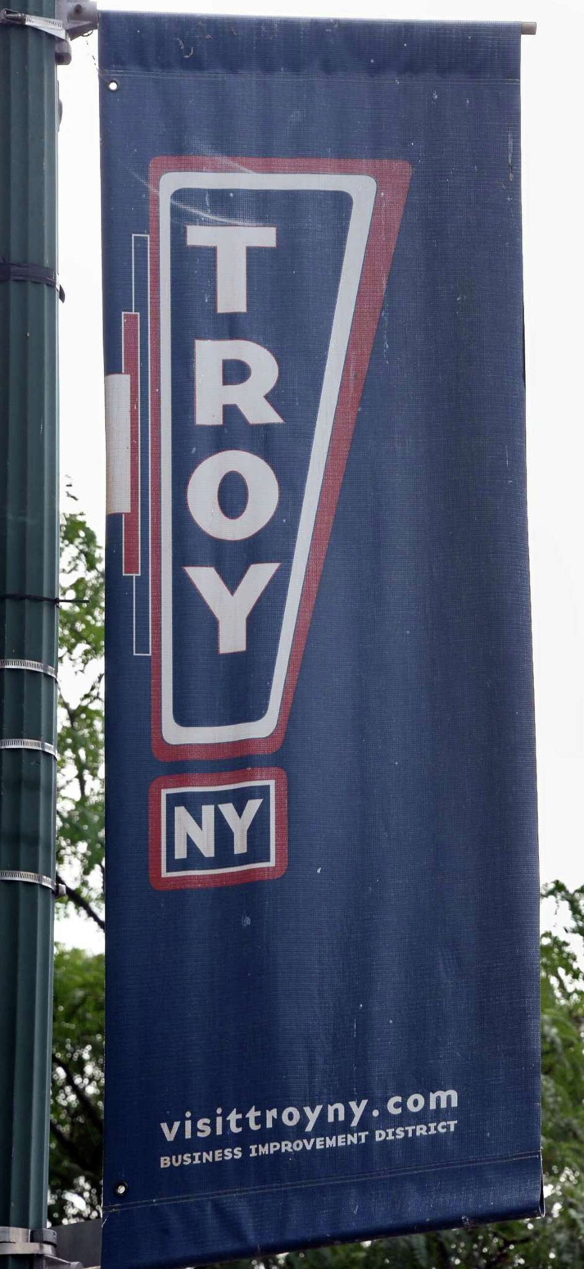 An old banner soon to be replaced by 100 new style street banners at Monument Square Friday Sept. 4, 2015 in Troy, NY. (John Carl D'Annibale / Times Union)