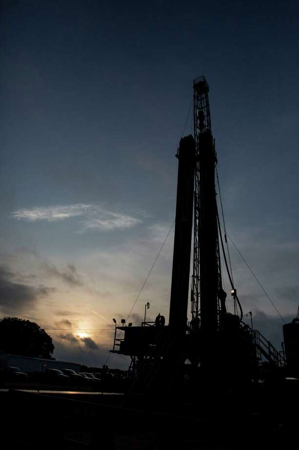 "There were 200 rigs in the Eagle Ford area at the start of the year, but by mid-December, there were fewer than 80. ""The drop in the number of rigs has been a big part of the story in South Texas,"" said Thomas Tunstall, research director at the University of Texas at San Antonio. Photo: Carolyn Van Houten /San Antonio Express-News / San Antonio Express-News"