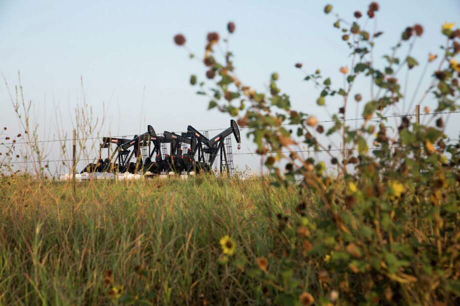 Six pumpjacks stand outside of Cotulla. The plunge in oil prices has forced drilling and oil service companies to fire workers and idle rigs throughout the Eagle Ford Shale area. Photo: Carolyn Van Houten /San Antonio Express-News