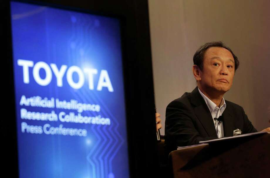 Kiyotaka Ise, senior managing officer for Toyota, listens to questions at a news conference Friday in East Palo Alto, Calif. Toyota announced it is investing $50 million with Stanford University and the Massachusetts Institute of Technology in an effort to use advances in AI technologies to make humans better drivers. Photo: Jeff Chiu /Associated Press / AP