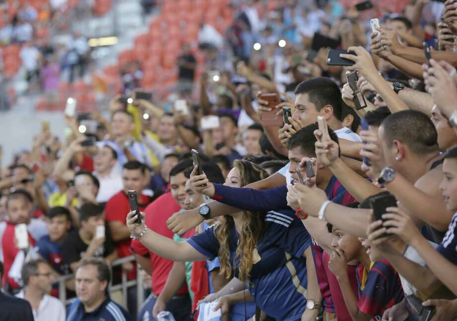 Fans wait to see the Argentina team take the field before a friendly match between Argentina and Bolivia, at BBVA Compass Stadium, Friday, Sept. 4, 2015, in Houston. Photo: Jon Shapley, Houston Chronicle / © 2015 Houston Chronicle