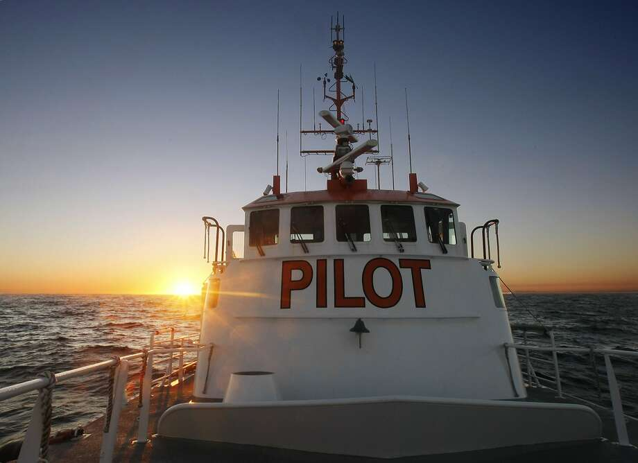 As the sun sets, the pilot boat San Francisco waits to transfer pilots to and from the large container ships and cruise liners that need the pilots to dock in the bay. Photo: Adm Golub, The Chronicle