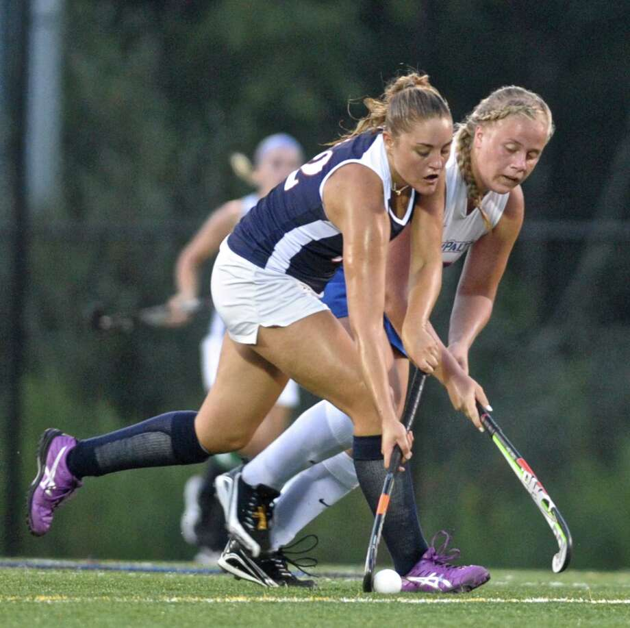 Western Connecticut's Jenny Cappello (12) and New Paltz's Jessica Caruana (16) battle for ball the during their field hockey game on Tuesday. On Friday, Cappello scored three goals in the Colonials' 11-0 win over Elms College. Photo: H John Voorhees III / Hearst Connecticut Media / The News-Times