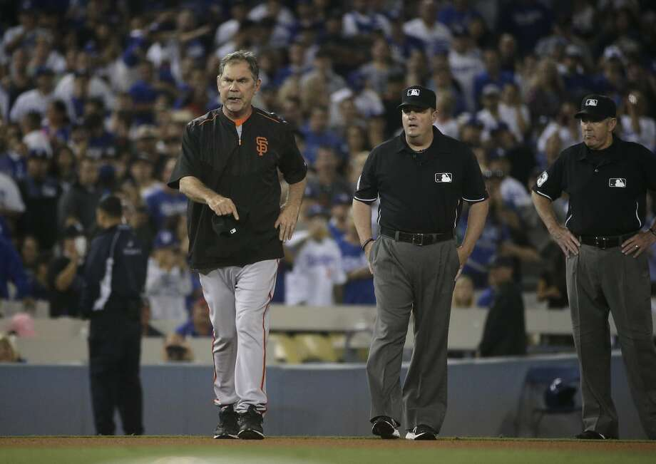 Bruce Bochy exits Wednesday's game after being ejected for the second night in a row by Mike Winters. Winters had called a check-swing third strike on Brandon Belt from third base. Photo: Jae C. Hong, Associated Press
