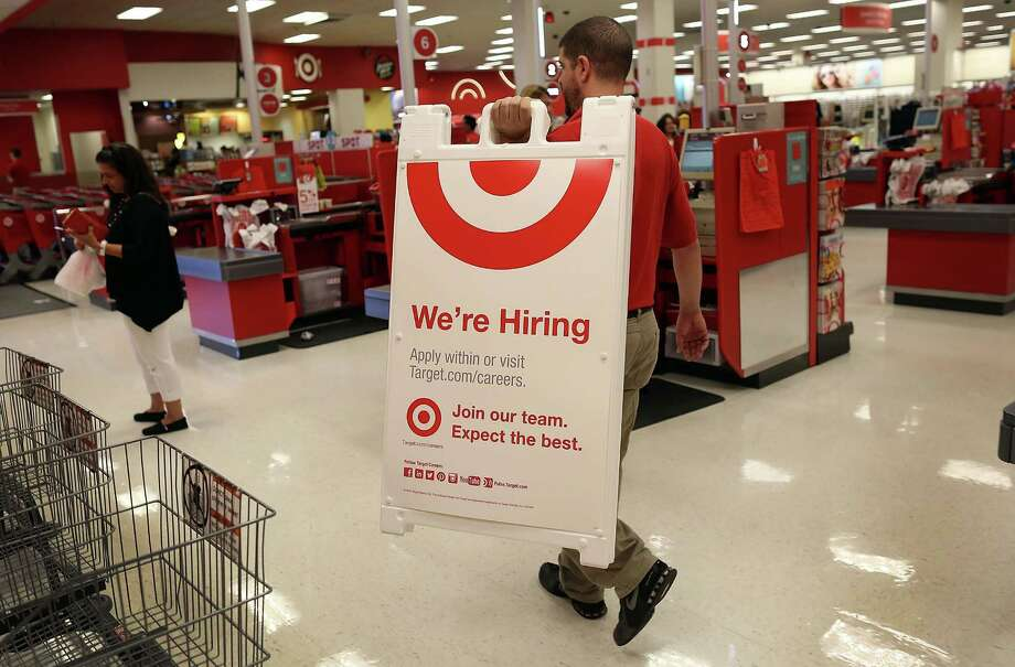 "A Target  manager    puts up a ""We're hiring"" sign at a Florida store  Friday. The August jobs report showed  just 173,000 new jobs.  Photo: Joe Raedle /Getty Images / 2015 Getty Images"