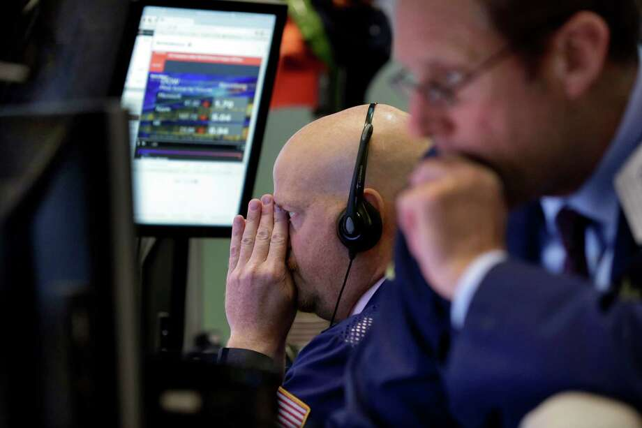 Trader Steven Gohl (left) works on the floor of the New York Stock Exchange on Wednesday. In the S&P 500, there have been 19 corrections since 1945, not including the current one, and 12 bear markets, for a total of 31 major downturns, according to S&P Dow Jones Indices. Photo: Richard Drew /Associated Press / AP