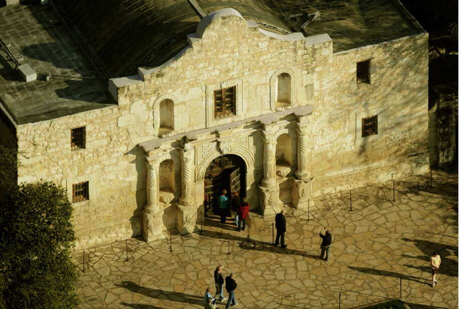 A man was arrested and charged with criminal mischief after a tour guide stopped him from carving his name into a wall of the Alamo in San Antonio on Thursday. Photo: BILLY CALZADA, STAFF / gcalzada@express-news.net