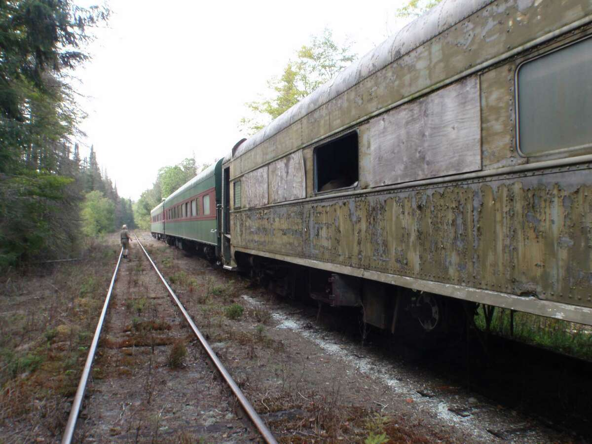 Dilapidated rail passenger cars stored on the lines of the Saratoga and North Creek in the Adirondack High Peaks are prone to decay and vandalism. (Courtesy of Protect the Adirondacks)