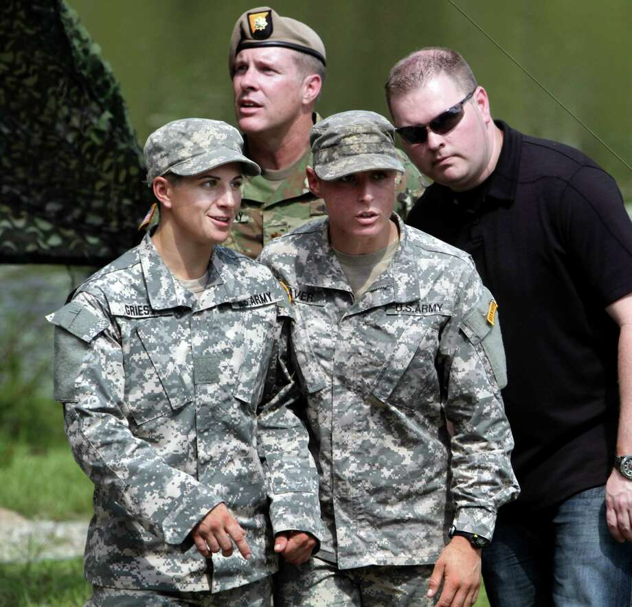 Capt. Kristen Griest, left, and 1st Lt. Shayne Haver talk after Ranger School graduation at Victory Pond on Aug. 21, in Columbus, Ga. The two women are the first female soldiers to earn and wear the Ranger tab. Photo: ROBIN TRIMARCHI /McClatchy-Tribune News Service / Columbus Ledger-Enquirer