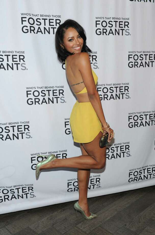 "IMAGE DISTRIBUTED FOR FOSTER GRANT - The Vampire Diaries actress and musician Kat Graham celebrates Foster Grant's 85th Anniversary, Thursday, July 17, 2014, at Gansevoort Park Avenue in New York. Graham is the latest star to be featured in the brand's historic ""Who's that behind those Foster Grants?"" ad campaign. Foster Grant is credited with the birth of sunglasses in the United States, selling the first pair on the Atlantic City boardwalk for 10 cents in 1929. (Photo by Diane Bondareff/Invision for Foster Grant/AP Images) ORG XMIT: INVL Photo: Diane Bondareff / Invision"