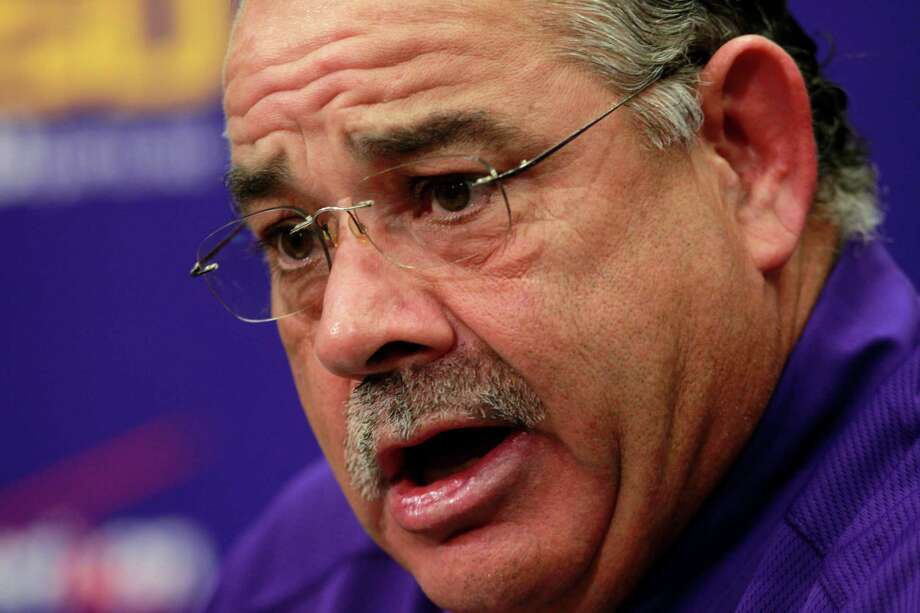 Texas A&M defensive coordinator John Chavis led the LSU Tigers to four finishes in the national top 12 in total defense in his six seasons, serving in the same role. Photo: Gerald Herbert, STF / AP