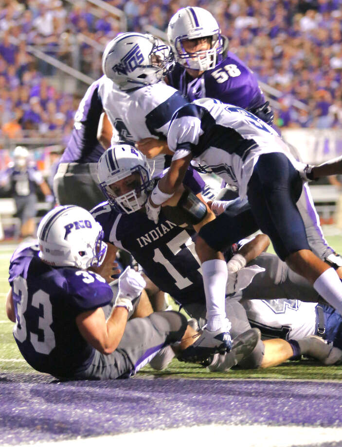 WO-S's Jeremiah Shaw, 21, collides with PNG's Trey Rembert, 2, during the game between the Port Neches-Groves Indians and the West Orange-Stark Mustangs at The Reservation, Friday, September 4, 2015.  Photo provided by Kyle Ezell