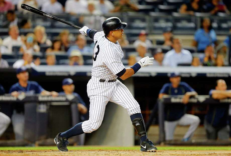 NEW YORK, NY - SEPTEMBER 04:  Alex Rodriguez #13 of the New York Yankees follows through on a second inning two run home run against the Tampa Bay Rays at Yankee Stadium on September 4, 2015 in the Bronx borough of New York City.  (Photo by Jim McIsaac/Getty Images) ORG XMIT: 538594221 Photo: Jim McIsaac / 2015 Getty Images