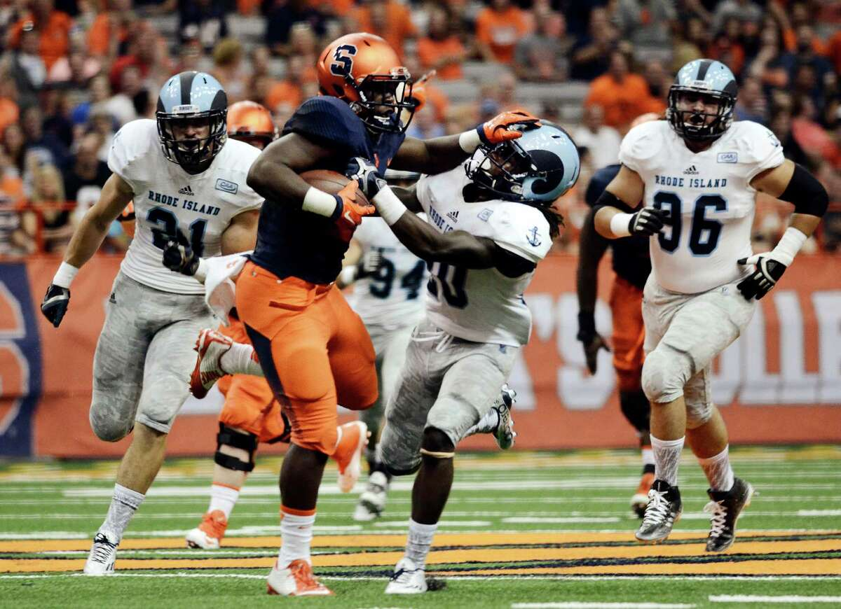 Syracuse's Jordan Fredericks, second from left, fends off Rhode Island's Ahkema Evans during the first half of an NCAA college football game at the Carrier Dome in Syracuse, N.Y., Friday, Sept. 4, 2015, (AP Photo/Heather Ainsworth) ORG XMIT: NYHA201