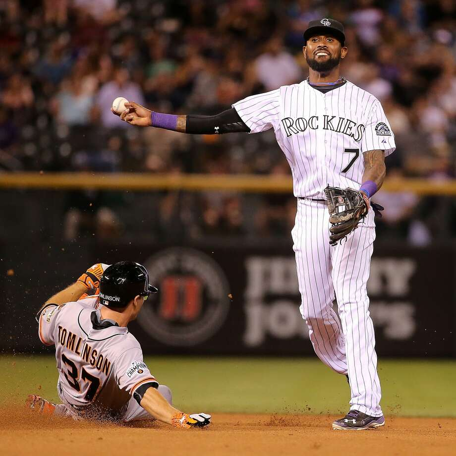 DENVER, CO - SEPTEMBER 04:  Shortstop Jose Reyes #7 of the Colorado Rockies turns a double play on Kelby Tomlinson #37 of the San Francisco Giants in the seventh inning at Coors Field on September 4, 2015 in Denver, Colorado.  (Photo by Doug Pensinger/Getty Images) Photo: Doug Pensinger, Getty Images