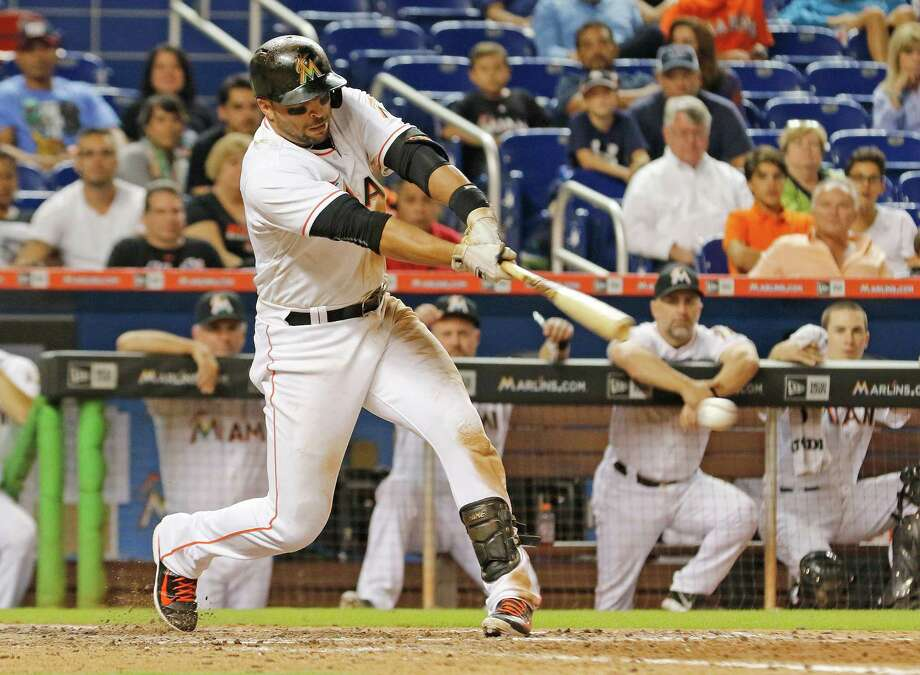 MIAMI, FL - SEPTEMBER 04:  Martin Prado #14 of the Miami Marlins hits the game-winning hit in the 11th inning to score teammate Christian Yelich as the Marlins defeat the New York Mets at Marlins Park on September 4, 2015 in Miami, Florida.  (Photo by Joe Skipper/Getty Images) ORG XMIT: 538594249 Photo: Joe Skipper / 2015 Getty Images