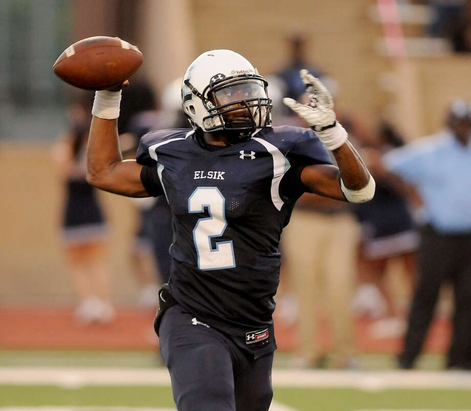 Elsik quarterback Devin Henderson passes downfield against Stratford at Crump Stadium Friday Sept. 4,2015.(Dave Rossman photo) Photo: Dave Rossman, For The Chronicle