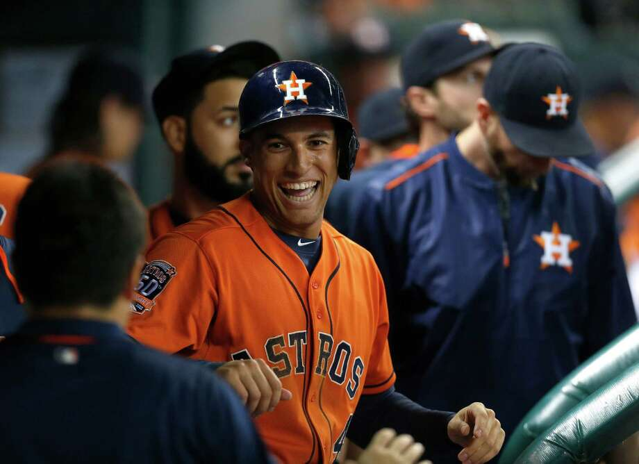 The Astros welcomed back George Springer, center, who was out with a fractured wrist, Friday night in an 8-0 win over the Twins. His .365 on-base percentage through the first 75 games of the season will be welcome, too. Photo: Karen Warren, Staff / © 2015 Houston Chronicle