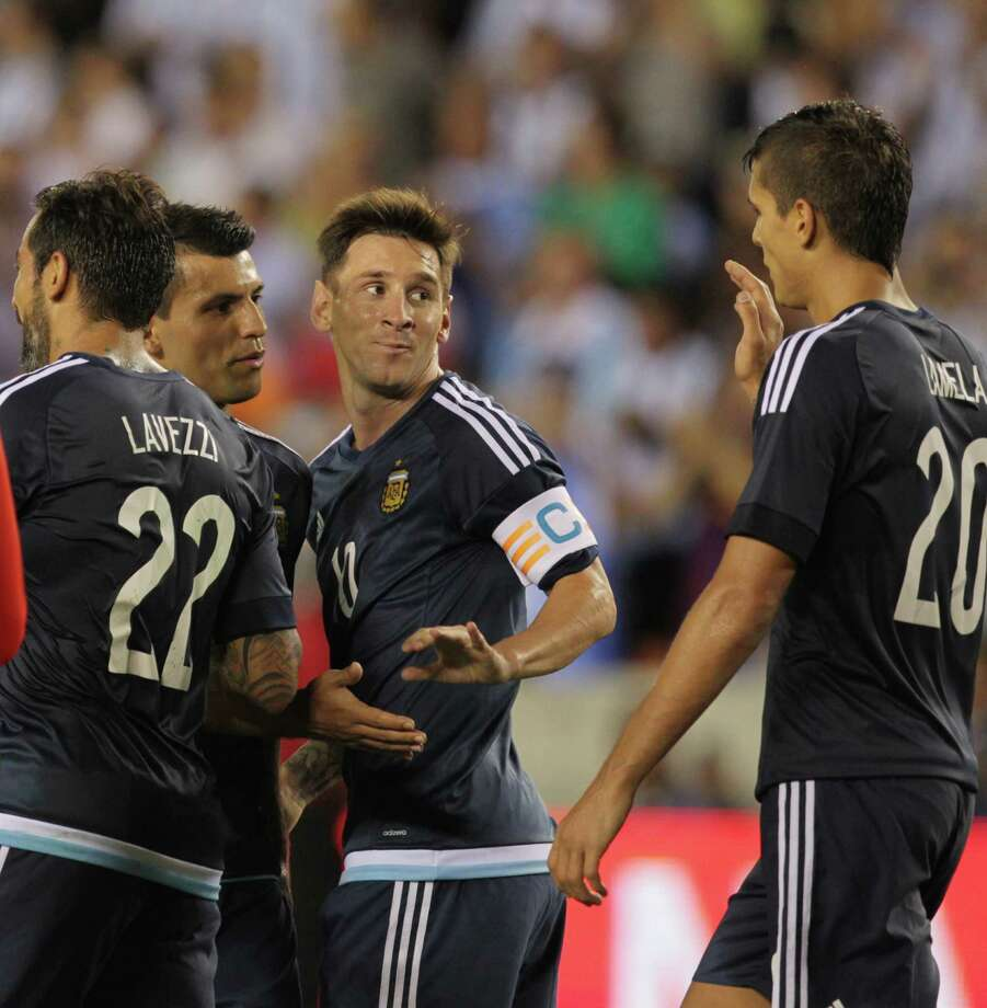 Lionel Messi, center, joined the fun a little late, but he still scored two goals and helped his team celebrate a 7-0 rout of Bolivia on Friday. Photo: Jon Shapley, Staff / © 2015 Houston Chronicle
