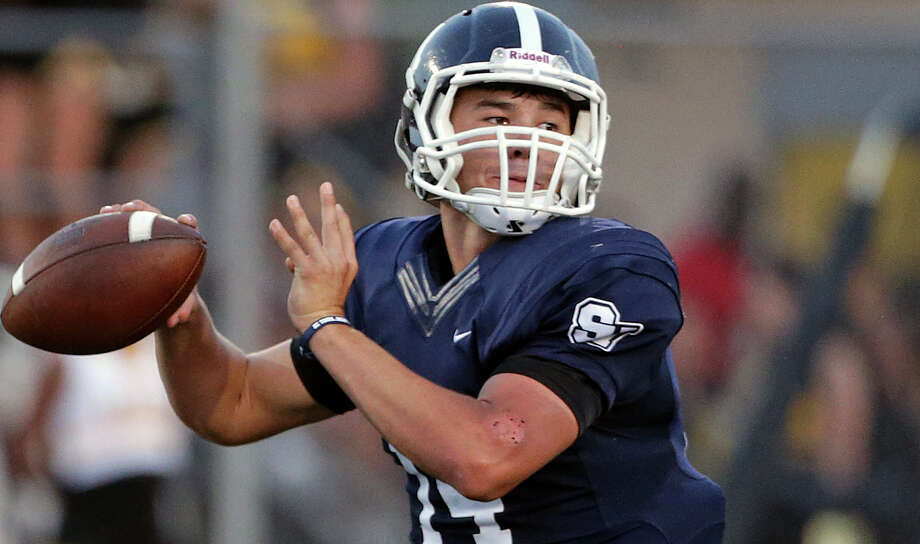 Rangers quarterback Josh Adkins throws in the first half as Smithson Valley hosts Brennan on Sept. 4, 2015. Photo: Tom Reel /San Antonio Express-News