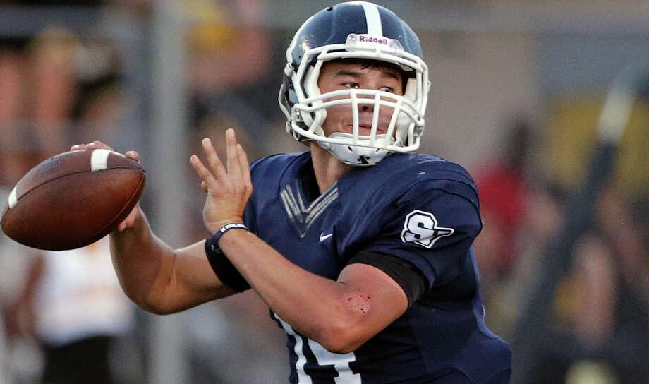 Rangers quarterback Josh Adkins throws in the first half as Smithson Valley hosts Brennan on Sept. 4, 2015. Photo: Tom Reel /San Antonio Express-News