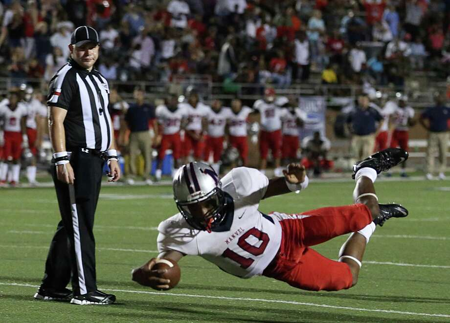 Manvel quarterback Deriq King (10) dives into the ends zone for a 10-yard touchdown late in his team's win over North Shore on Friday. Photo: Thomas B. Shea / © 2015 Thomas B. Shea
