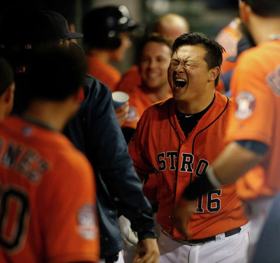Hank Conger has plenty to laugh about Friday night. The Astros catcher relishes a fourth-inning grand slam with teammates and later added an RBI single. Photo: Karen Warren, Staff / © 2015 Houston Chronicle