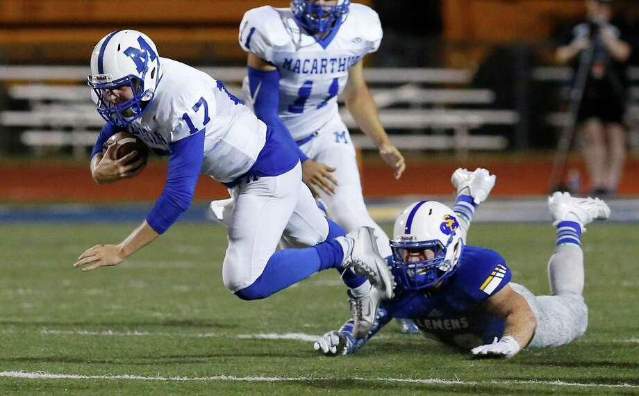 MacArthur quarterback Tyler Vitt (17) gets tripped up by a Clemens defender during a possession at Lehnhoff Stadium on Friday, Sept. 4, 2015. Photo: Kin Man Hui /San Antonio Express-News / ©2015 San Antonio Express-News