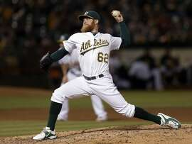 Oakland Athletics pitcher Sean Doolittle works against the Seattle Mariners during the sixth inning of a baseball game Friday, Sept. 4, 2015, in Oakland, Calif. (AP Photo/Ben Margot)