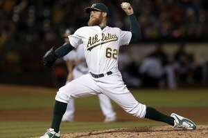 A's take long route to 11-8 loss to Seattle - Photo