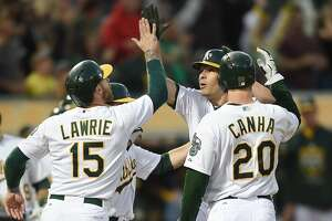 A's take long route to 11-8 loss - Photo