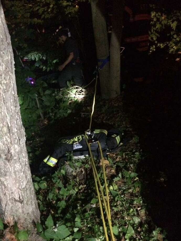 Using searchlights and ropes, Greenwich firefighters performed a technical rescue to retrieve a Greenwich man who fell down a Byram River embankment late Friday on Sept. 4, 2015. Photo: Greenwich Fire Department