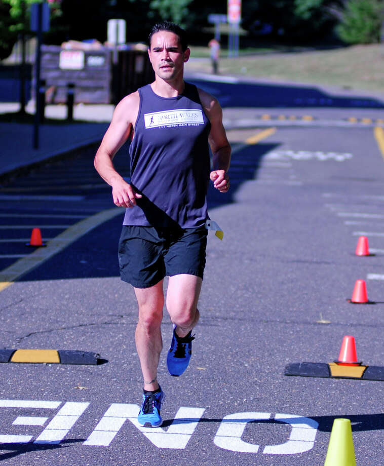 Ridgefield's James Osborn crosses the finish line in first place in the Westport Road Runners 10-mile Labor Day weekend race on Satruday, Sept. 5, 2015 at Staples High School in Westport, Connecticut. Osborn's time was 57:54. Photo: Ryan Lacey/Staff Photo / Westport News Contributed