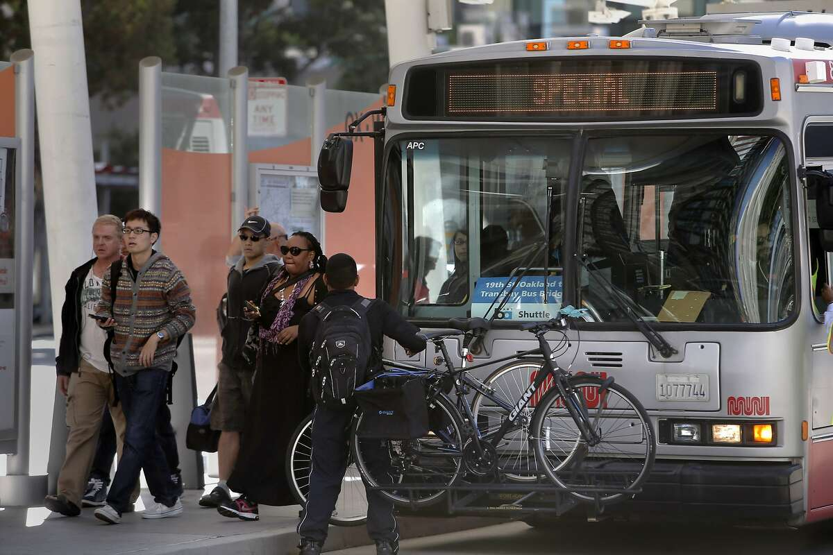 Passengers arrive at the Transbay Terminal in San Francisco, Calif. after taking the bus bridge from Oakland, during the Labor Day weekend closure of the BART transbay tube for repairs on Sat. September 5, 2015.