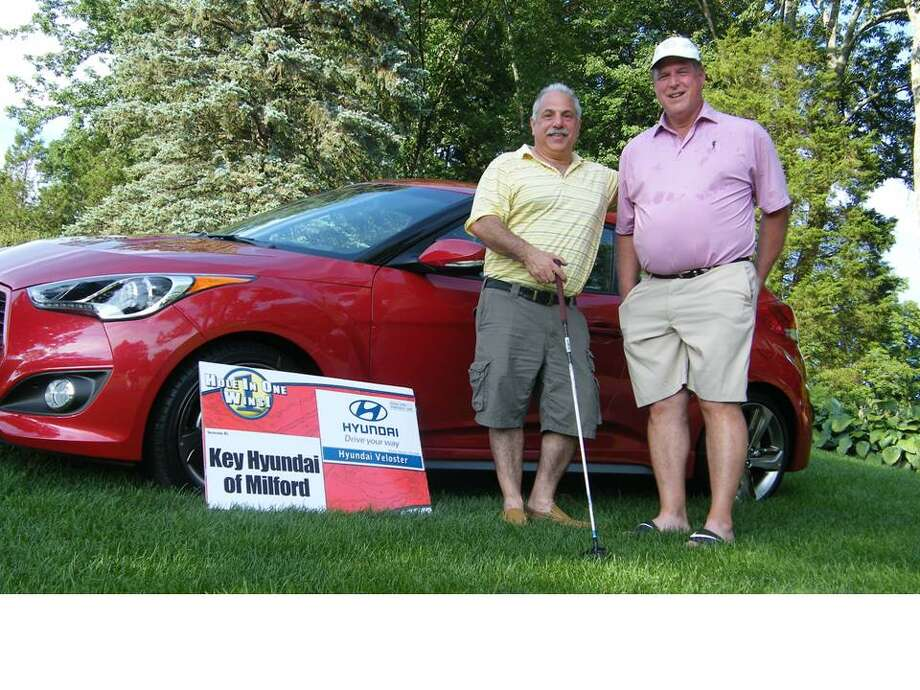 Pictured in front of the 2014 Hyundai Veloster with Key Hyundai sign is winner Mike Battista (left) with playing partner Joe Sileo. Photo: /