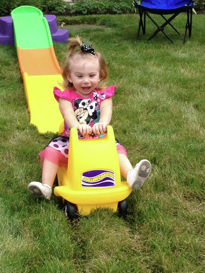 "Two-year-old Molly Hatch enjoys the thrill of a roller coaster at a friend?s birthday party this summer. ""Her face was just so priceless,"" says her mom, Margaret Hatch. (Margaret Hatch)"